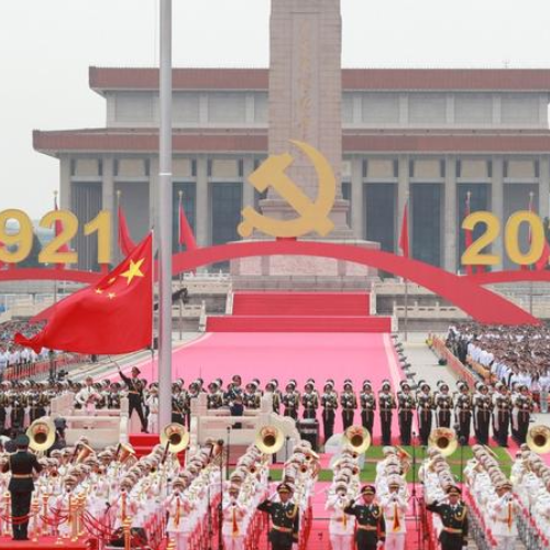 The national flag is raised during a grand ceremony held at Tian'anmen Square in Beijing, July 1, 2021, to celebrate the 100th anniversary of the Communist Party of China.
