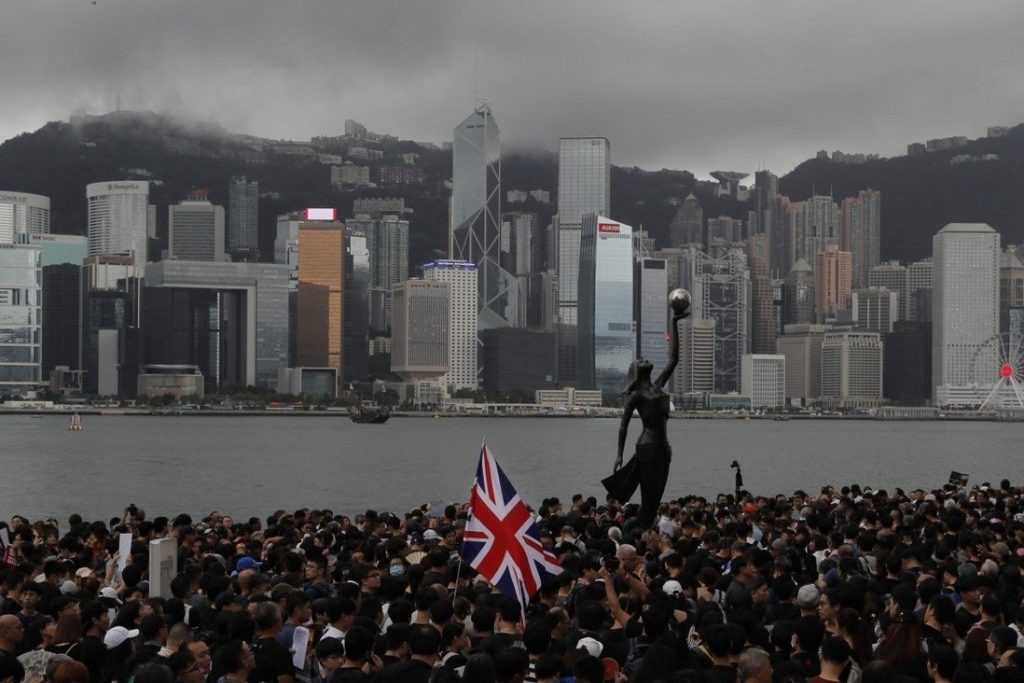 Demonstrators fly the British flag during the Hong Kong protests in 2019. Photo: AP