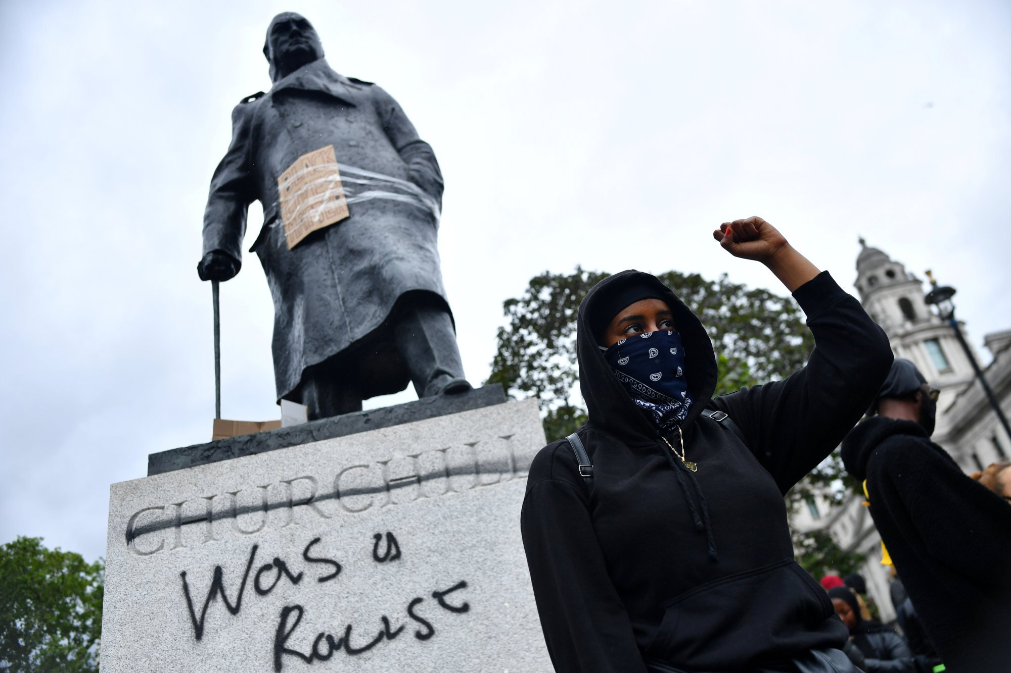 Graffiti on a statue of Winston Churchill in Parliament Square, London, during a Black Lives Matter protest. Photo: Reuters